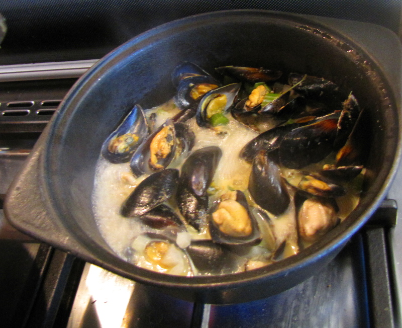 Mussels steaming in a white wine sauce